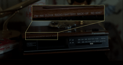 Home alone altered still: the parent's alarm, highlighting the model and battery backup